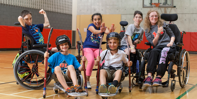 kids in wheelchairs with hockey sticks