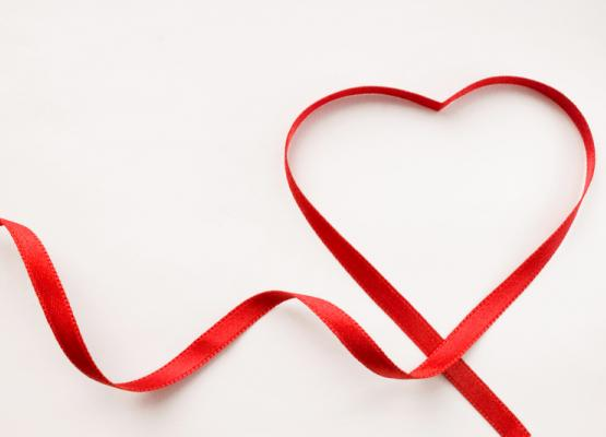 Red ribbon shaped in a heart
