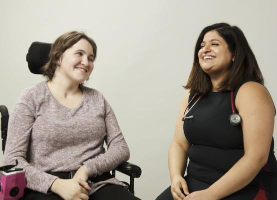Teen girl in wheelchair with woman with stethoscope around her neck