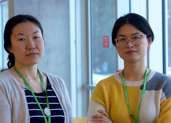 Two Asian hospital staff members