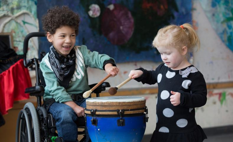 Kids playing drums in music therapy