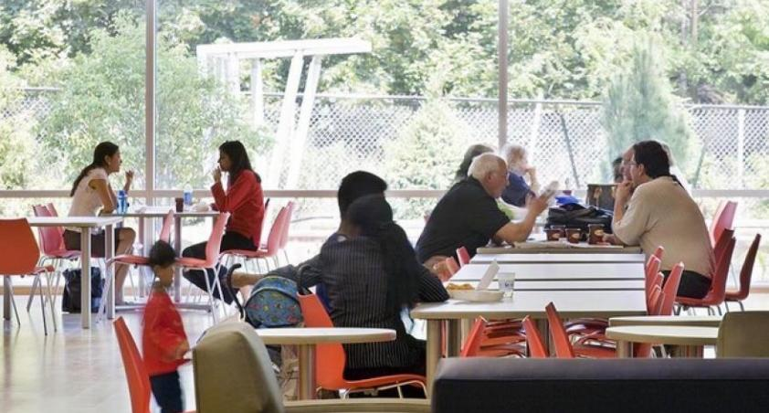 Clients and visitors eating in the cafeteria