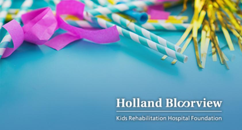 Holland Bloorview logo pink streamers, blue and white striped straws, and gold tinsel above it