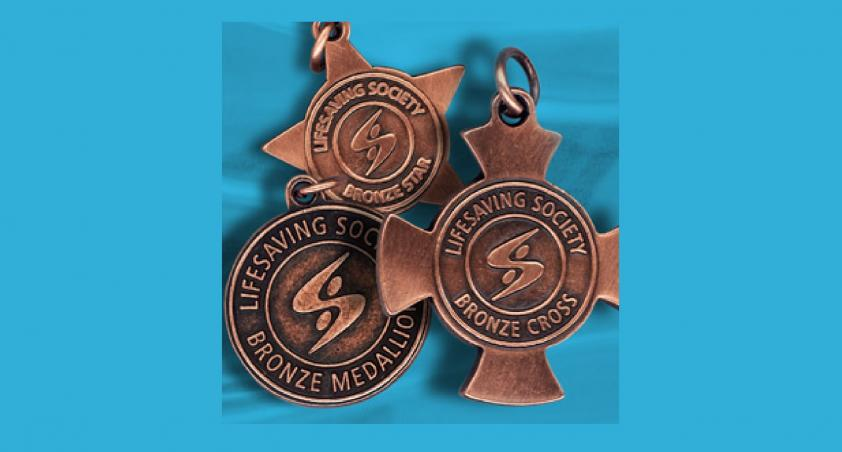 bronze cross medals on blue