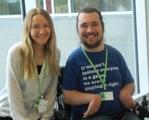 Close up of young woman and young man in wheelchair