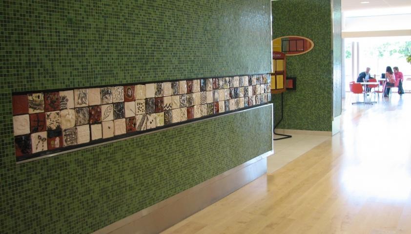 Artistic ceramic tiles are incorporated into the architecture and design of the building