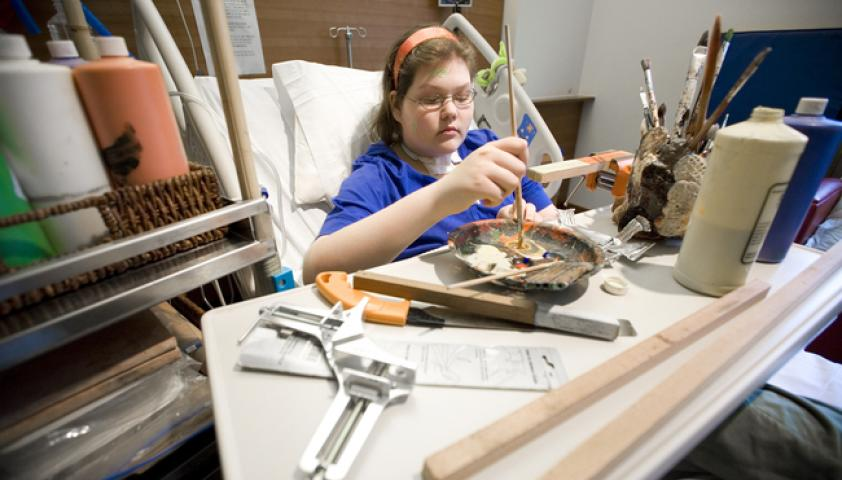 ARTery trolleys visit children's bedsides packed with paints, brushes and clay