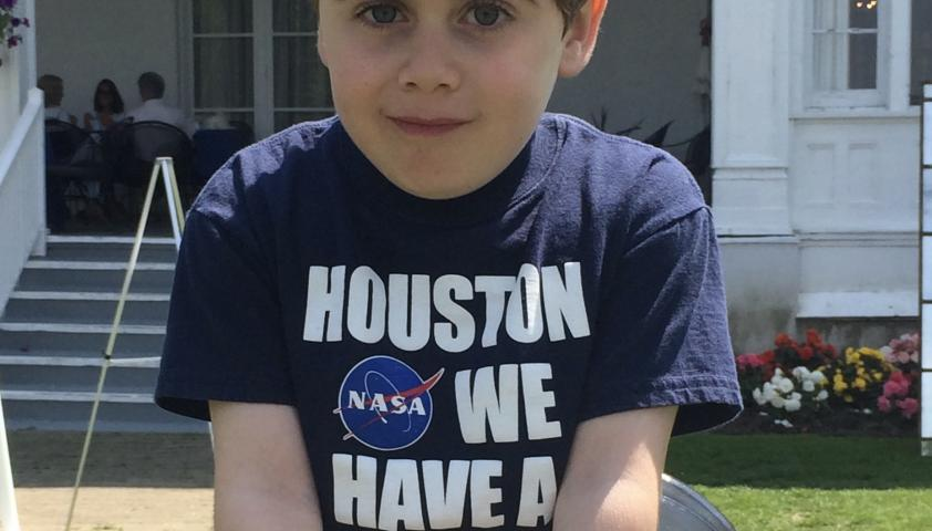 Emery sitting down, wearing a NASA shirt