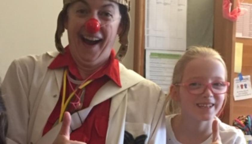 Olivia with Dr. Flap, the therapeutic clown