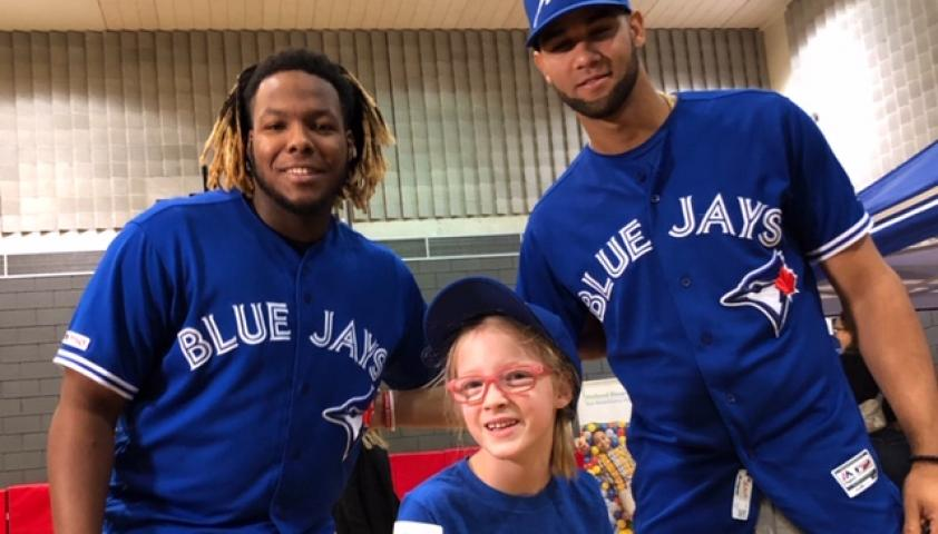 Olivia posing with the Toronto Blue Jays