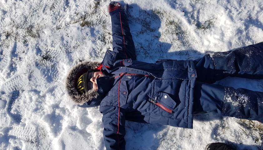 Alex making snow angels