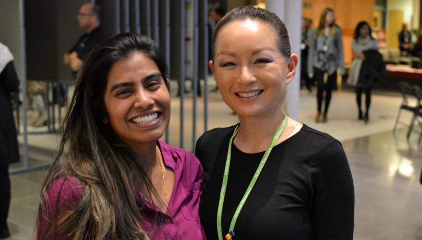 Jeannie Fong, research operations assistant, and Shalini Rajeshwaran, human resources and trainee coordinator, looking relaxed after a successful morning of  presentations.