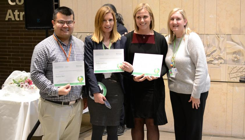 Dr. Shauna Kingsnorth, manager of Evidence to Care (far right), presents the 2019 winners of the Evidence to Care People's Choice Poster Award. Winning team (Left to Right): Sunny Bui, Dr. Sally Lindsay, Dr. Kendall Kolne