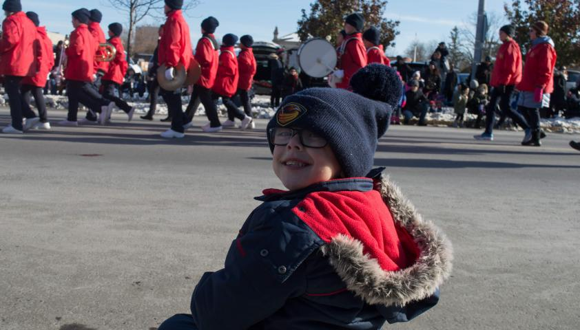 Alex watching a parade