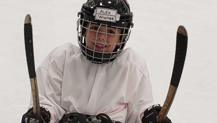 Alex playing sledge hockey.